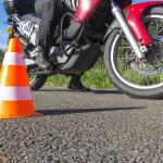 biker taking practical test off road