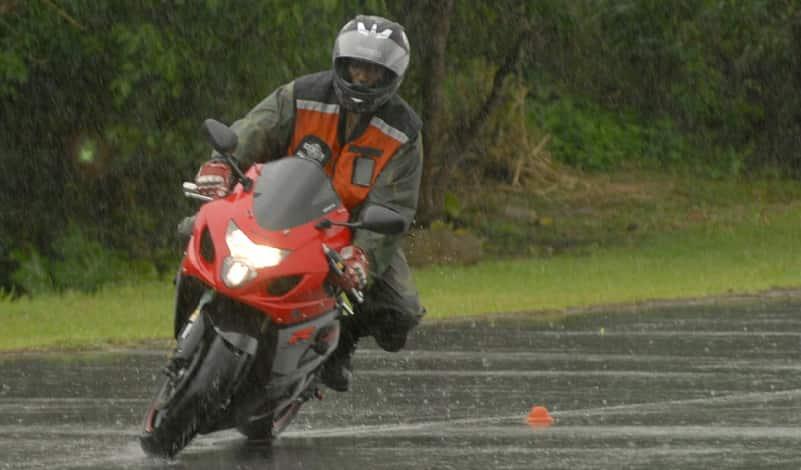 Motorbike riding in rain