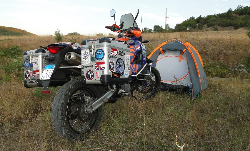 motorcyle parked outside tent