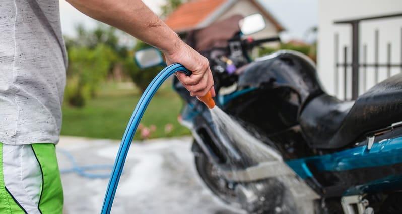 hosing motorbike down