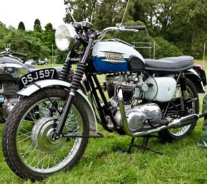 Black and white motorcycle number plate on classic bike.