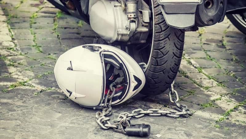helmet chained to motorbike wheel
