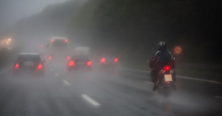motorcyclist in rain on motorway